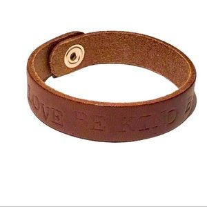 Handtooled brown leather self affirmation cuff